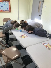 3rd through 5th graders participating in an activity that requires no hands or arms!